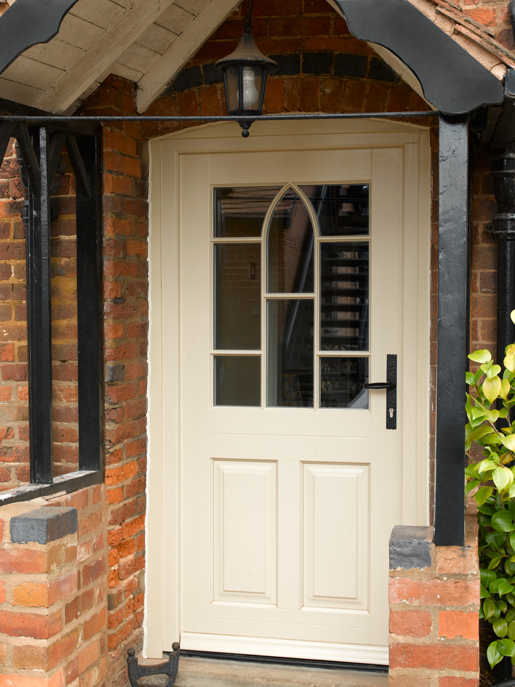 Cream-front-entrance-door-porch-glass-detail-wrought-iron-furniture