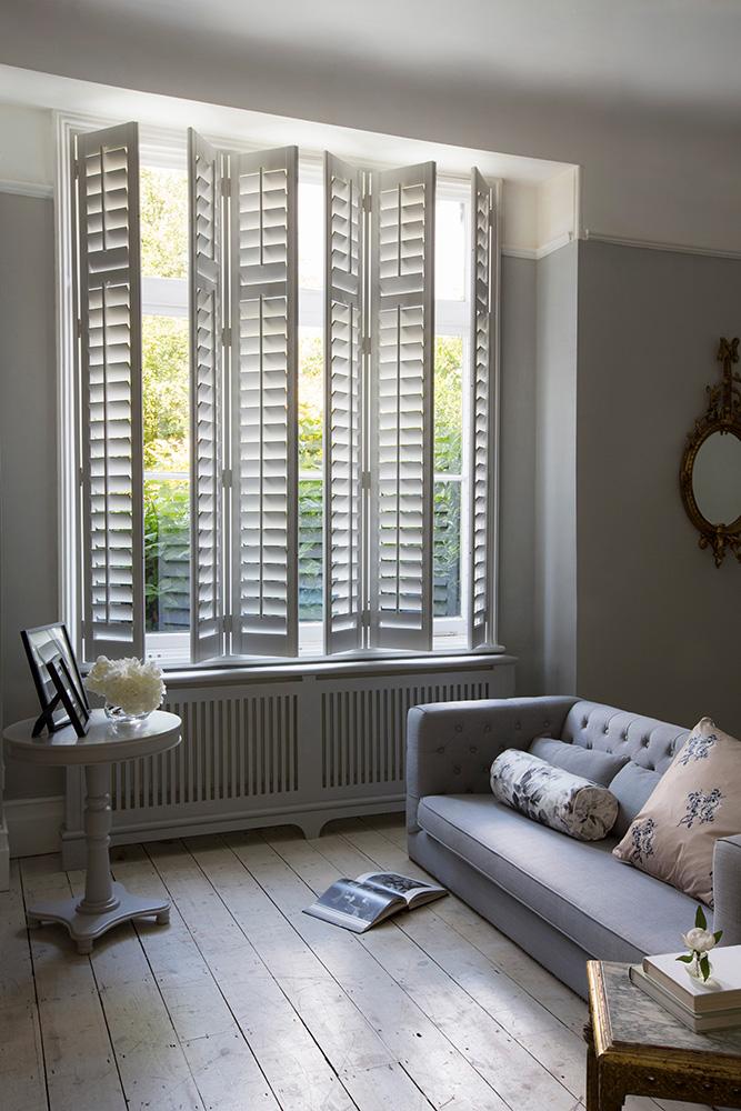 Open plantation shutter living room full height tilt rod
