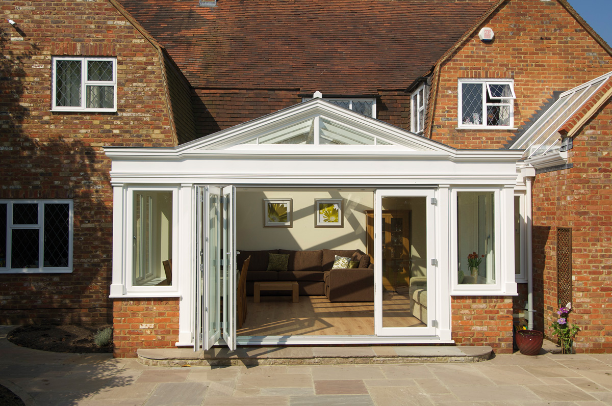 bifold-timber-doors-orangery-exterior-white-five-panel-side-door