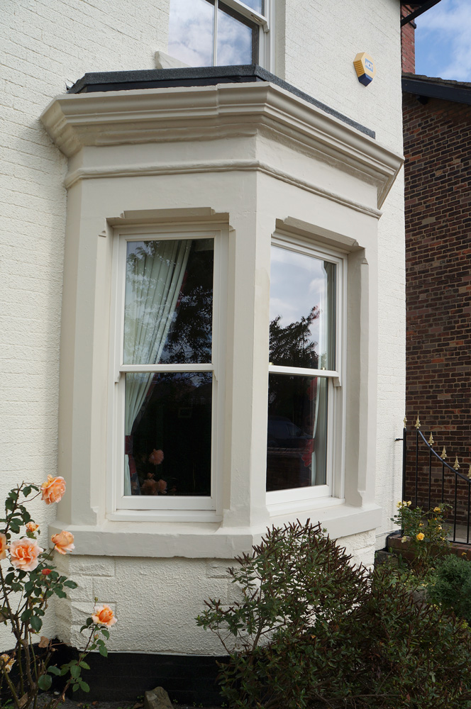 Sash box bay window in cream