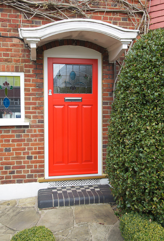 red-front-entrance-door-stained-glass-panel-chrome-furniture