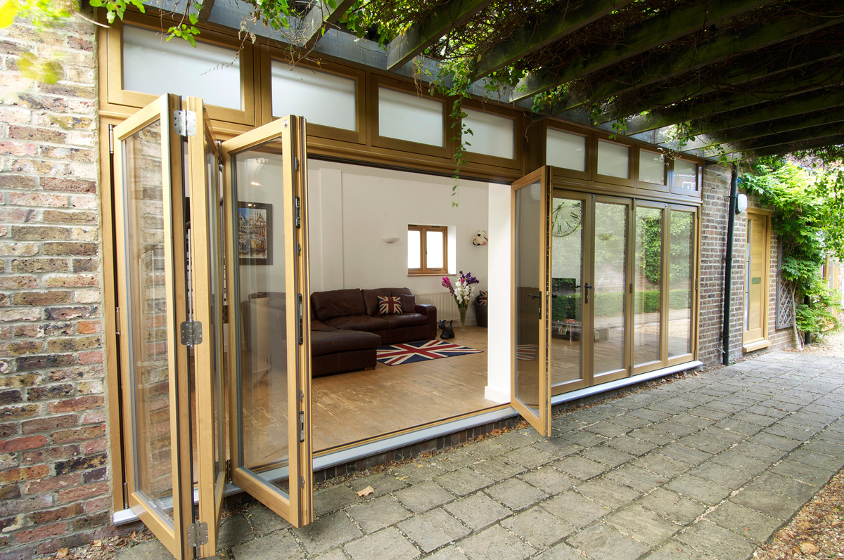 Doors ideas design for barn doors and patio doors wall for Exterior folding doors